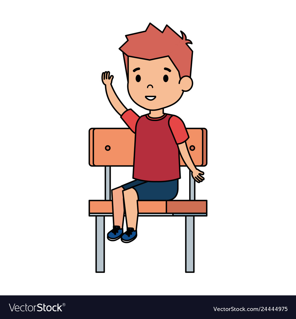 Cute little boy sitting in schoolchair.