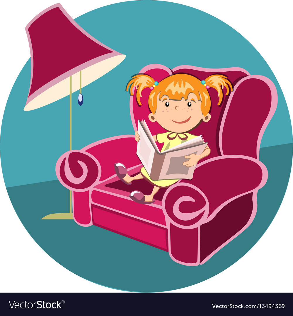 Little girl reading a book in an armchair.