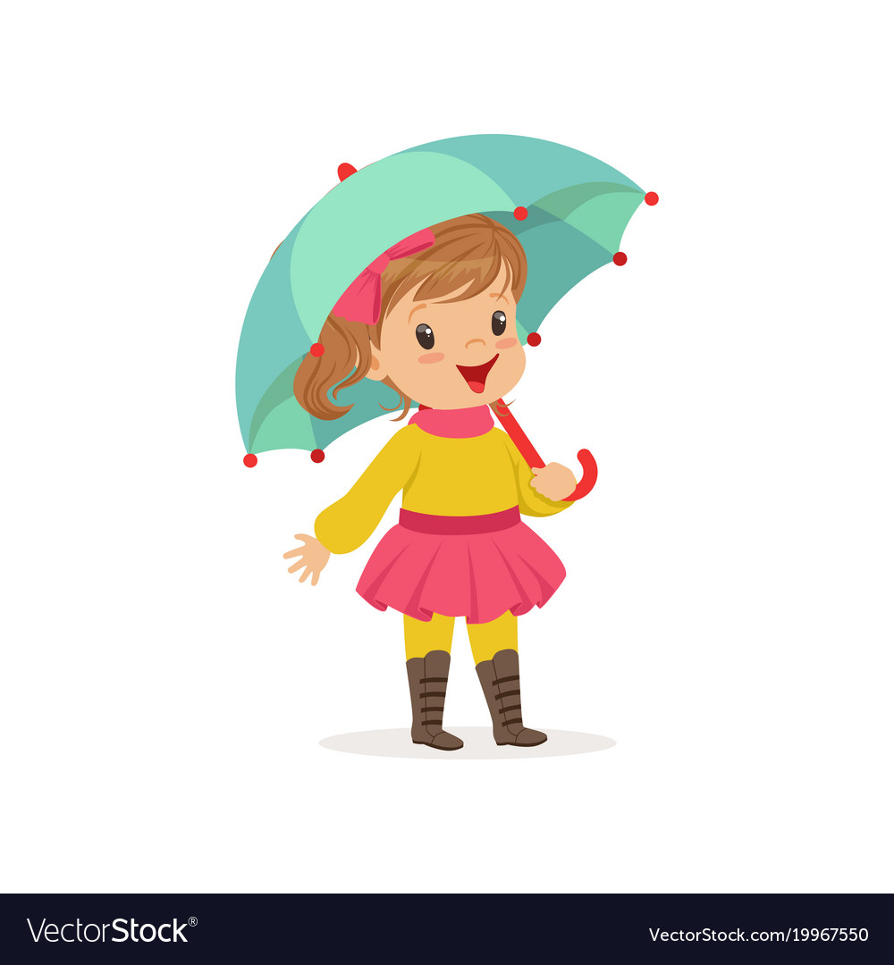 Sweet little girl in warm clothing walking with.