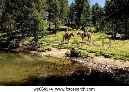 Stock Photo of Horseback trail riding by Prese little lake from.