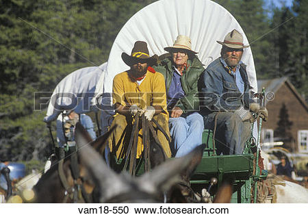 Stock Photography of Living History participants in wagon train.