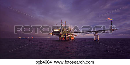 Stock Photo of North Sea. Oil production platform with tanker.