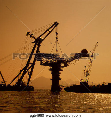 Stock Photography of Crane barge lifting topside onto oil loading.