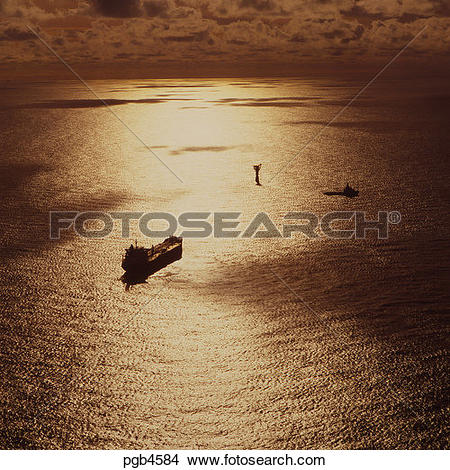 Stock Photo of North Sea oil industry. Tanker approaching loading.