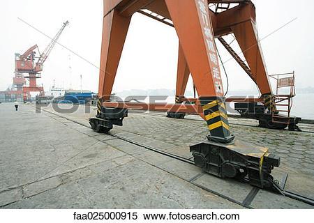 Stock Image of Loading crane on rails in shipyard faa025000915.