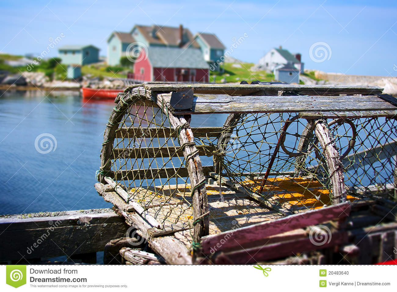 Lobster Trap And Fishing Village Stock Photo.