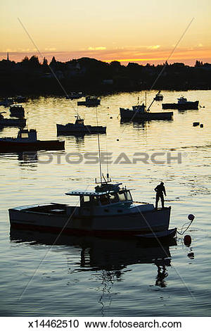 Stock Photography of Silhouette of lobster boats and lobstermen.