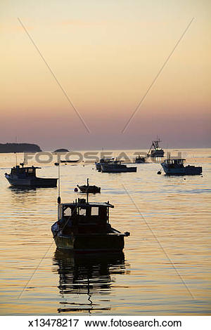 Picture of Silhouette of lobster boats and lobstermen Maine.