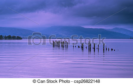 Stock Photo of Loch Lomond jetty and mountains at sunset.