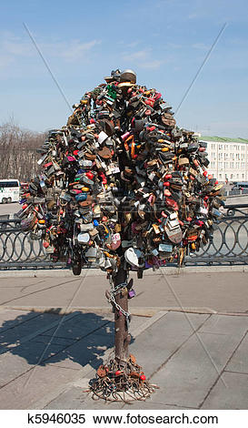 Stock Image of A tree with wedding locks on Luzhkov bridge. Moscow.