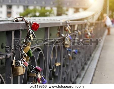 Stock Images of Close up of locks strung on urban bridge bld119356.
