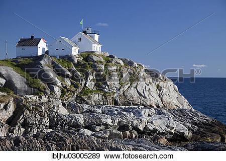 "Stock Photograph of ""Coastal cliffs and the lighthouse."