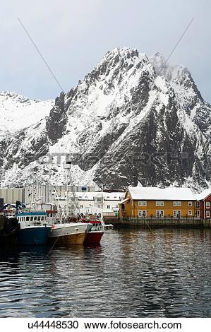 Stock Photography of View of harbour and snow capped mountains.