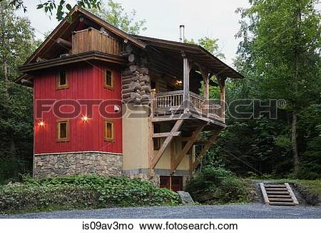 Stock Photo of Rear view of cottage style log home with stone.