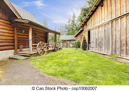 Stock Photography of Log house exterior and shed..