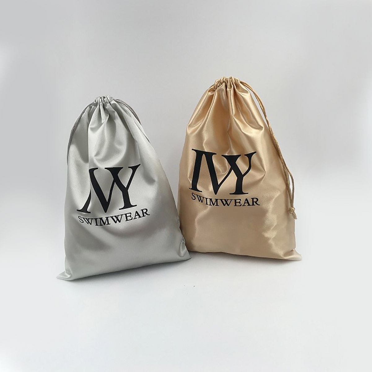 Golden Satin Drawstring Bag With Black Logo Print.