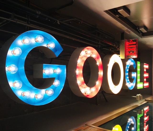 Google Light Bulb Logo Sign On Ceiling.