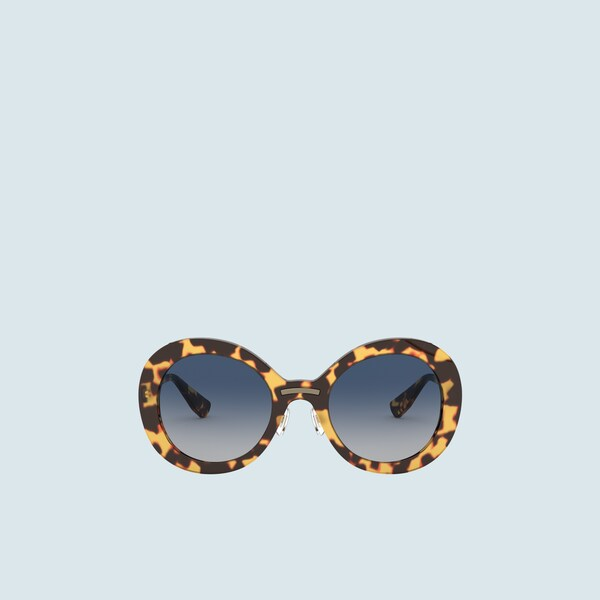 Miu Miu Logo sunglasses.