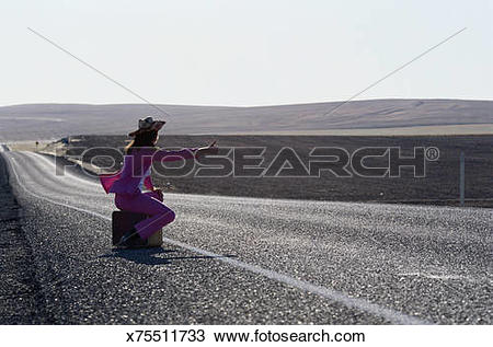 Stock Photo of Hitchhiker on Lonely Road x75511733.