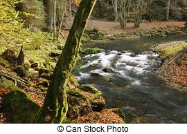Stock Photo of A mountain stream waterfall, long time exposure.