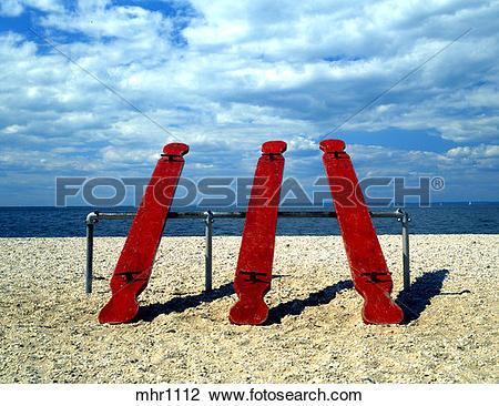 Stock Photo of Red Seesaws On A Playground Alongside The Long.