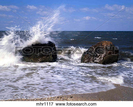 Picture of Waves Crashing Over Boulders Near The Shoreline, Long.
