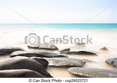 Stock Photo of long time exposure of sea wave with rock on the.