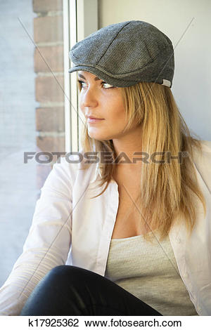 Stock Photo of Woman in white upper suit look outside k17925362.