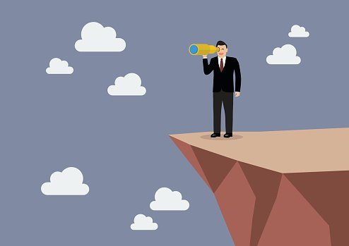 Businessman looking for business future on the cliff Clipart.