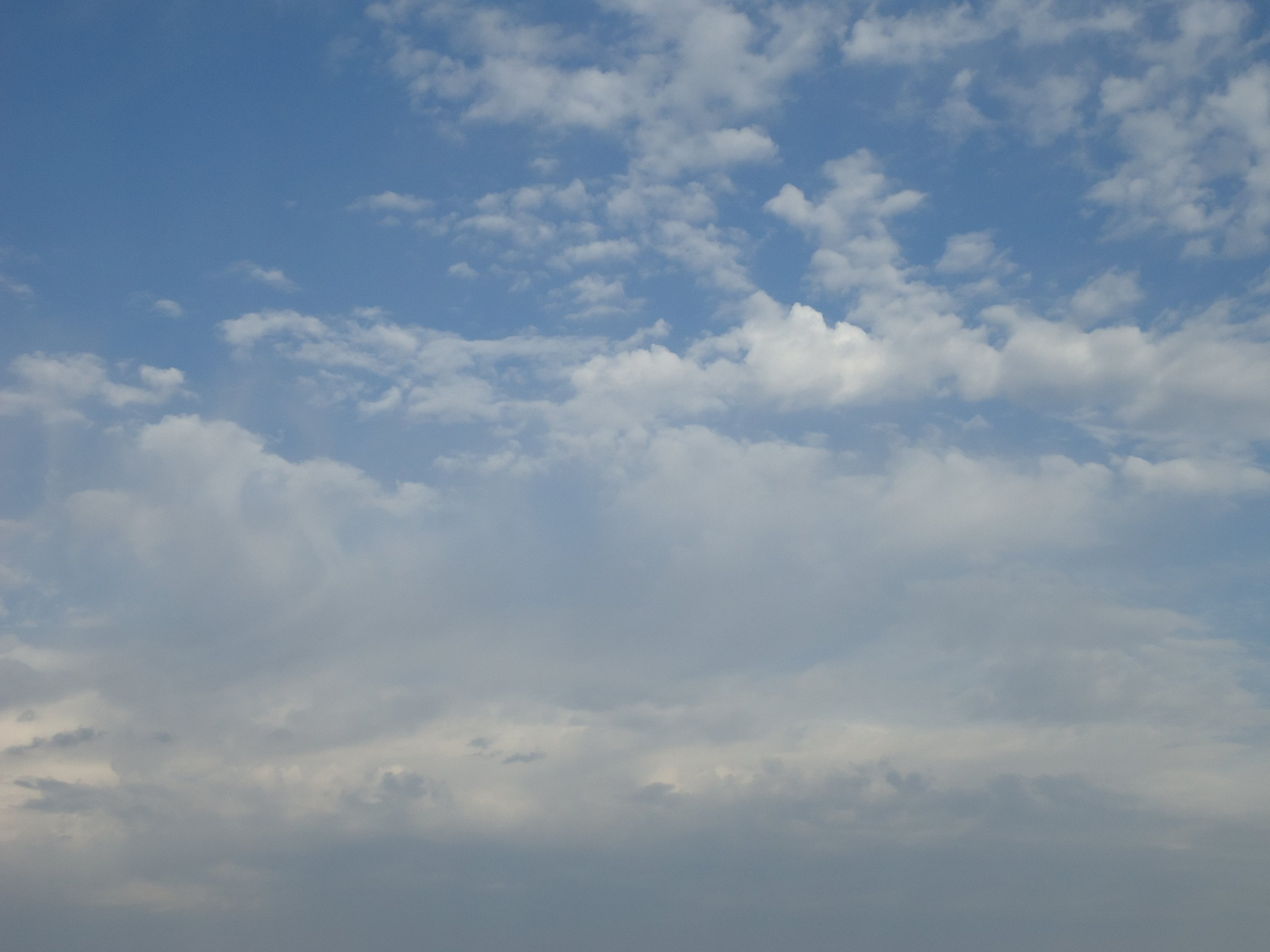 Cloud patterns in partly cloudy sky.