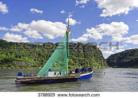 Stock Photograph of Old fishing boat in front of Loreley on Rhine.