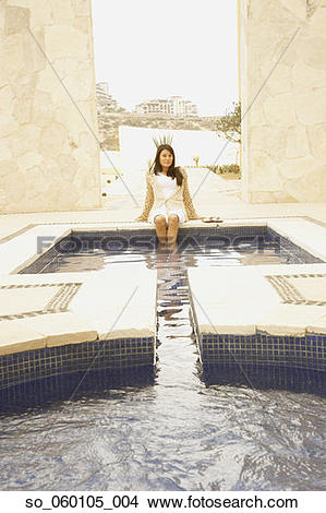 Stock Photo of Woman with feet in outdoor hot tub, Los Cabos.