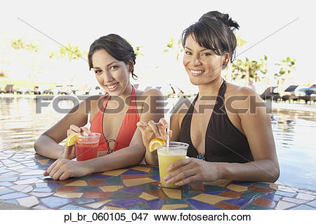 Picture of Two Hispanic women at hotel pool bar, Los Cabos, Mexico.