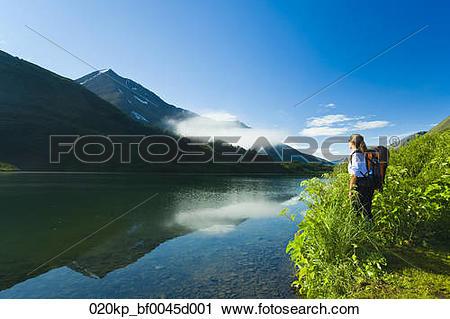 Stock Photography of Woman hiking next to Carter Lake, Chugach.