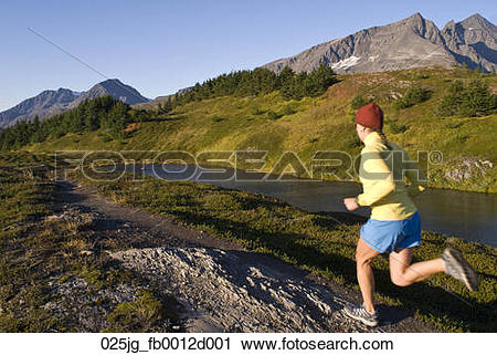 Stock Photography of Woman runs the Lost Lake Trail in the Chugach.