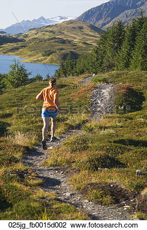 Stock Photo of Woman runs the Lost Lake Trail in the Chugach.