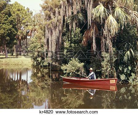 Stock Photography of Fishing Louisiana Bayou Boat Fisherman Man.