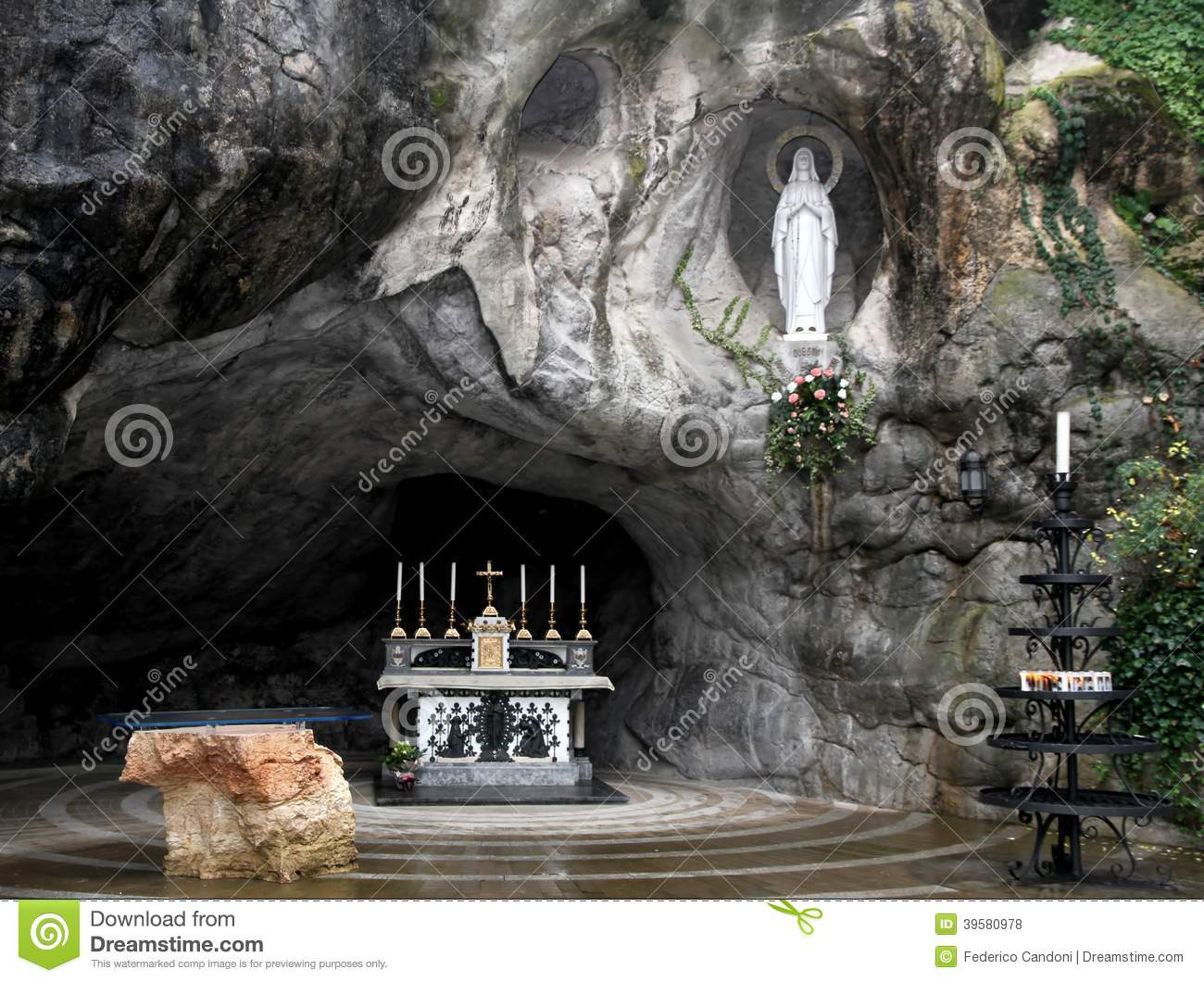 Statue Of The Virgin Mary In The Grotto Of Lourdes Attracts Many.