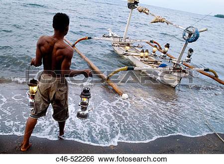 Stock Images of Fisherman, Lovina beach. Bali Island, Indonesia.