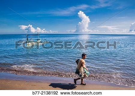 Stock Photo of fisherman at Lovina Beach, North Coast of Bali.