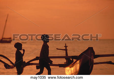 Stock Image of Silhouetted children passing by a traditional.