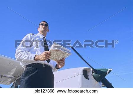 Pictures of Low Angle Shot of a Pilot Holding a Map and Standing.