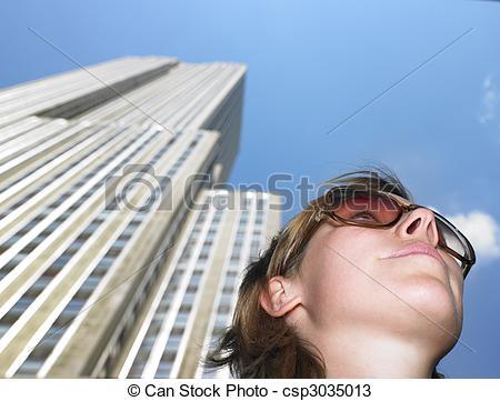 Stock Photos of Young Woman Beneath Skyscraper.