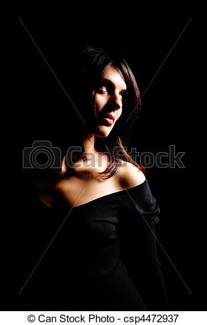 Picture of Low key portrait of a young woman with side lighting.