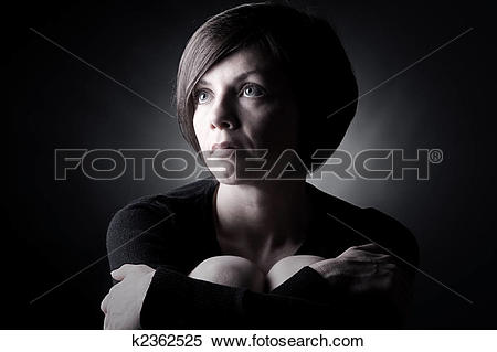 Stock Image of Low Key Shot of a Pretty Brunette Lady Looking Up.