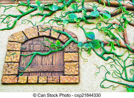 Stock Photos of Low relief cement of tree on wall..