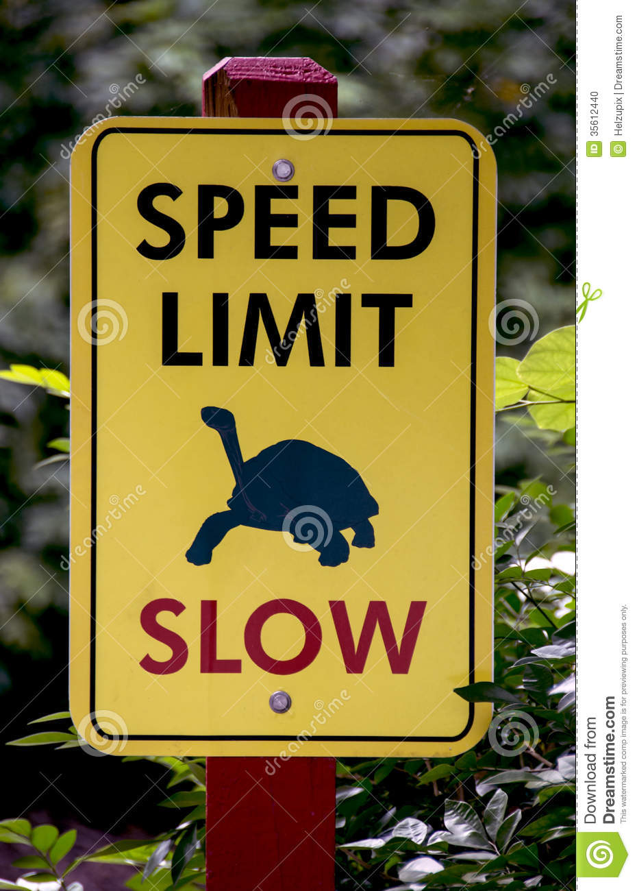 Slow Speed Limit Sign Stock Photo.