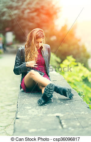 Stock Photography of Girl sitting on a low wall.