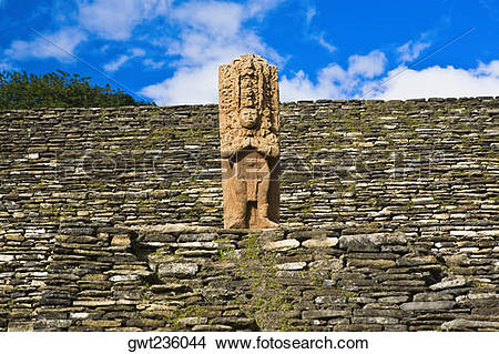 Stock Photo of Low angle view of a statue on a stone wall, Tonina.