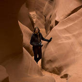 Stock Photo of Woman standing in a slot canyon, Corkscrew Canyon.